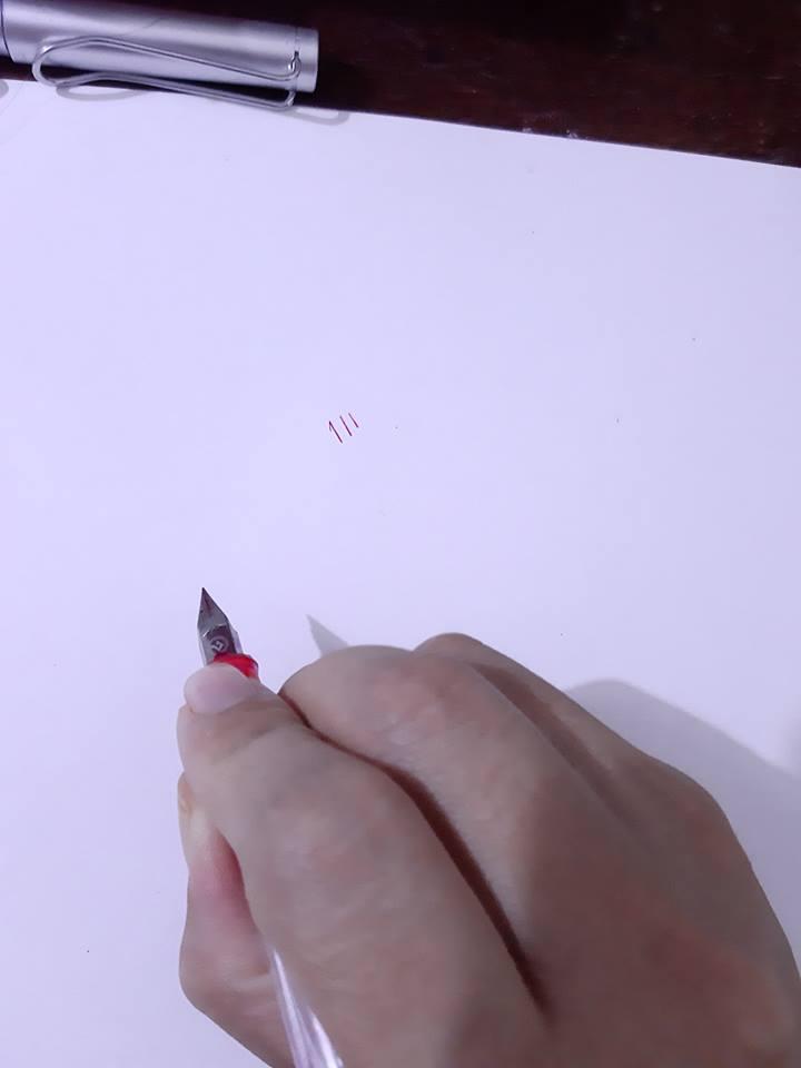 cách cầm bút để viết chữ đẹp